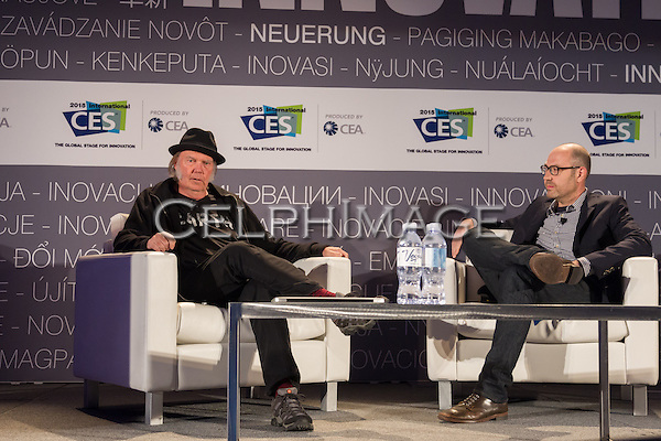 """NEIL YOUNG, NATHAN BRACKETT. Presentation """"Neil Young on Why High-Resolution Music Matters"""" at the 2015 Consumer Electronics Show, Las Vegas Convention Center. Las Vegas, NV, USA. January 7, 2015. ©CelphImage."""