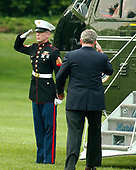 United States President George W. Bush salutes a Marine guard as he boards Marine One en route to visiting the United States Army Special Command in Fort Bragg, North Carolina in Washington, D.C. on July 4, 2006.  The President was visiting Fort Bragg to celebrate Independence Day. <br /> Credit: Ron Sachs - Pool via CNP