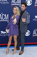 07 April 2019 - Las Vegas, NV - Chuck Wicks, Kasi Williams. 54th Annual ACM Awards Arrivals at MGM Grand Garden Arena. Photo Credit: MJT/AdMedia<br /> CAP/ADM/MJT<br /> &copy; MJT/ADM/Capital Pictures