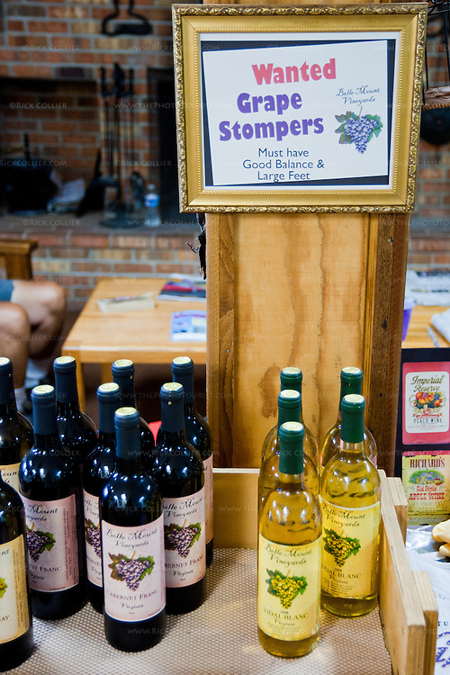 "Sign in the tasting room at Belle Mount Vineyards:  ""Grape Stompers Wanted."""