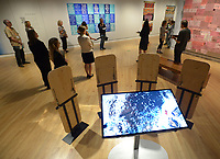 NWA Democrat-Gazette/ANDY SHUPE<br /> A video plays Thursday, Oct. 4, 2018, near a set of ceremonial shields that are a part of a piece titled &quot;Mirror Shield Project&quot; by artist Cannupa Hanska Luger, during a tour of a new exhibition of artwork by Native American artists at Crystal Bridges Museum of American Art in Bentonville. The exhibition, titled &quot;Art for a New Understanding: Native Voices, 1950s to Now,&quot; opens today and runs through Jan. 7, 2019.