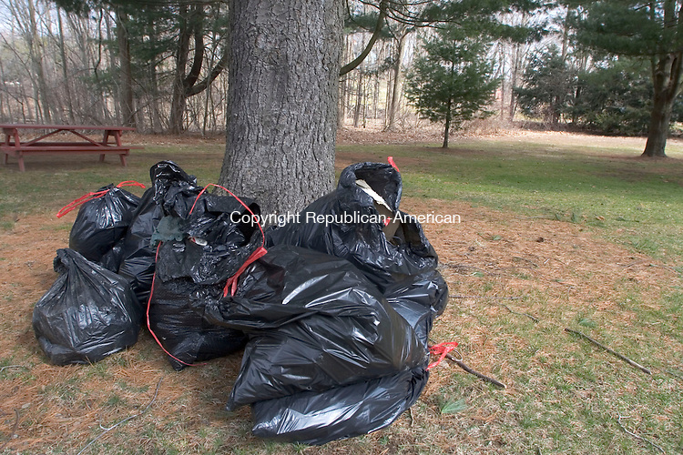 WOODBURY, CT - 07 APRIL 2007 - 040707JW13.jpg -- Plastic bags filled with trash start piling up at Hollow Park during the town of Woodburys annual spring townwide cleanup Saturday morning. Jonathan Wilcox Republican-American