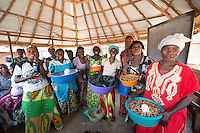 Africa, DRC, Democratic Republic of the Congo, South Kivu, Kamanyola. Women for Women project. WFW Kamanyola co-op and lifeskills training. Women learning small business, selling rice, beans, flour, beer, charcoal. Beatrice Mukulimu (40 yrs, in blue) is the co-op leader). She's married with 9 kids.