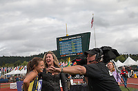 Laura Roesler shares a laugh with ESPNU reporter Jill Montgomery after her victory in the 800-meters at the 2014 NCAA Division I Outdoor Track and Field Championships, Friday, June 13, in Eugene, Or.