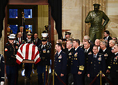 The casket bearing the remains of former US President George H.W. Bush arrives at the US Capitol during the State Funeral in Washington, DC, December 3, 2018. - The body of the late former President George H.W. Bush travelled from Houston to Washington, where he will lie in state at the US Capitol through Wednesday morning. Bush, who died on November 30, will return to Houston for his funeral on Thursday. (Photo by Brendan SMIALOWSKI / AFP)