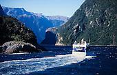 A tourist ferry re-enters Milford Sound, Fiordland National Park, South Island, New Zealand.