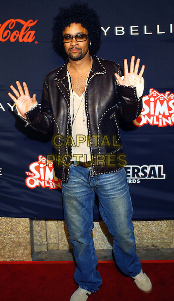 SHAGGY.Teen People's 5th Anniversary Party held at The Ivar in Hollywood .denim, jeans, full length, full-length, hands in air, black leather jacket.www.capitalpictures.com.sales@capitalpictures.com.©Capital Pictures