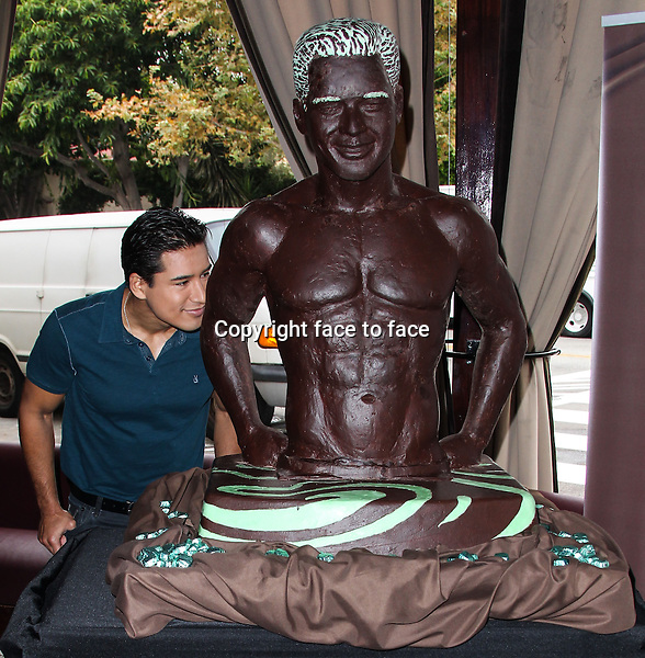 LOS ANGELES, CA - AUGUST 01: Mario Lopez Unveils Life-Size Dove Chocolate Look-A-Like Sculpture At The Grove To Help Launch New Dove Silky Smooth Mint &amp; Dark Chocolate Swirl on August 1, 2013 in Los Angeles, California.<br /> Credit: MediaPunch/face to face<br /> - Germany, Austria, Switzerland, Eastern Europe, Australia, UK, USA, Taiwan, Singapore, China, Malaysia, Thailand, Sweden, Estonia, Latvia and Lithuania rights only -