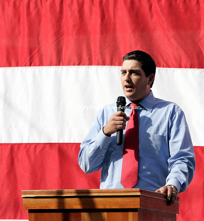 Torrington, CT- 11, September 2011-091111CM04 Torrington Mayor Ryan Binghman addresses the audience during 9/11 Memorial Service at the North End Fire Station in Torrington Sunday morning.  Bingham said he was in college at Marist, and remembers classmates running frantically to contact loved ones who lived in New York.   A piece of steel beam from the World Trade Center North Lobby was unveiled and will be displayed  in a memorial outside of the fire station.   Christopher Massa Republican-American