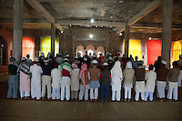 Congregation Assembled for Mid-day Prayers in Mosque under Construction, Madrasa Islamia Arabia Izharul-Uloom, Dehradun, India.