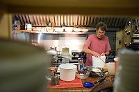 Lida Kaiser prepares food for the Saturday evening guests at the Hamilton Club in Morris Run, PA.