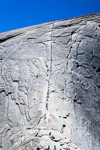 LINE OF PEOPLE CLIMBING TO TOP OF HALF DOME IN YOSEMITE NATIONAL.PARK, CALIFORNIA
