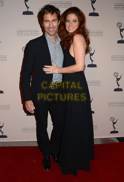 Eric McCormack, Debra Messing<br /> The Television Academy presents An Evening Honoring James Burrows at The Academy of Television Arts &amp; Sciences in North Hollywood, California, USA.<br /> October 7th, 2013<br /> full length dress suit check shirt side black sleeveless  <br /> CAP/ADM/BT<br /> &copy;Birdie Thompson/AdMedia/Capital Pictures