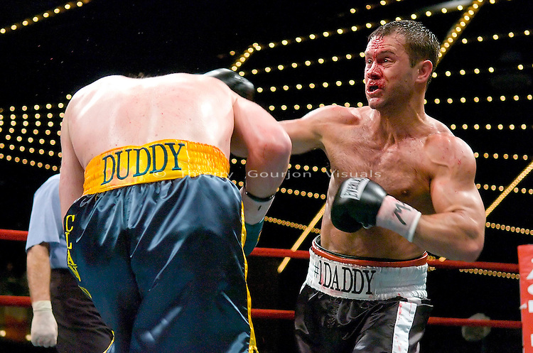 Anthony &quot;The Bullet&quot; Bonsante lands  on &quot;Ireland's&quot; John Duddy during their  IBA World &amp; WBC Continental Americas Middleweight Championship at the Garden in New York City on 03.16.07.<br />