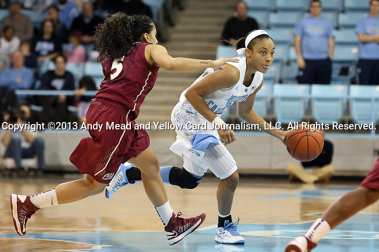 31 January 2013: North Carolina's Latifah Coleman (right) and Florida State's Yashira Delgado (5). The University of North Carolina Tar Heels played the Florida State University Seminoles at Carmichael Arena in Chapel Hill, North Carolina in an NCAA Division I Women's Basketball game. UNC won the game 72-62.