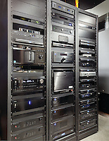 The front of these home automation equipment racks are beautifully engineered to look sleek and neat.