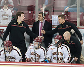 Kevin Hayes (BC - 12), Kevin Pratt (BC - Student Manager), Marty McInnis (BC - Assistant Coach), Johnny Gaudreau (BC - 13), Bill Arnold (BC - 24), Bert Lenz (BC - Director-Sports Medicine), John Hegarty (BC - Dir-Hockey Ops) - The Boston College Eagles defeated the visiting University of Massachusetts Lowell River Hawks 3-0 on Friday, February 21, 2014, at Kelley Rink in Conte Forum in Chestnut Hill, Massachusetts.