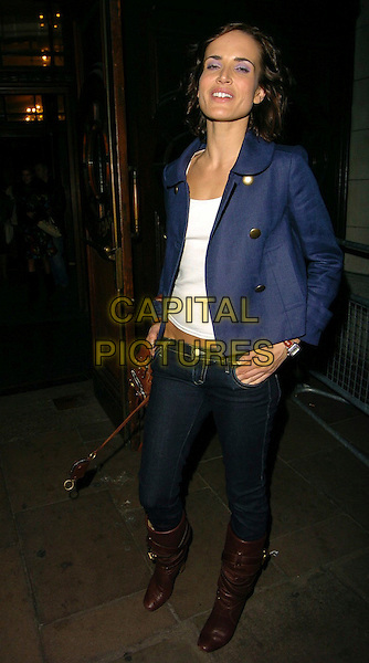 SOPHIE ANDERTON.At Myla's Debutante's Lingerie Fashion Show,.Porchester Hall, London, England, .January 31st 2006..full length blue jacket brown leather bag knee high boots jeans tucked into.Ref: CAN.www.capitalpictures.com.sales@capitalpictures.com.©Can Nguyen/Capital Pictures