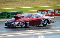 Sept. 22, 2012; Ennis, TX, USA: NHRA pro stock driver Warren Johnson during qualifying for the Fall Nationals at the Texas Motorplex. Mandatory Credit: Mark J. Rebilas-