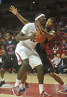 NWA Media/Michael Woods --11/21/2014-- w @NWAMICHAELW...University of Arkansas forward Bobby Portis drives to the hoop past Delaware State defender Kendall Gray in the first half of Friday nights game against Delaware State at Bud Walton Arena in Fayetteville.