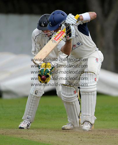 Carlton CC V Grange CC, Scottish National Cricket League, Premier Division, at Grange Loan, Edinburgh - Grange stand-in wicket-keeper Gregor Maiden safely tucks the bll in his gloves to tke the wicket of Carlton's Frser Watts - Picture by Donald MacLeod 25.07.09