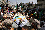 The body of a Palestinian security man is carried by his comrades during his funeral, in Rafah, southern Gaza Strip August 17, 2017. Photo by Ashraf Amra