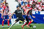 Filipe Luis (r) of Atletico de Madrid fights for the ball with Gabriel Ivan Mercado of Sevilla FC during the La Liga 2017-18 match between Atletico de Madrid and Sevilla FC at the Wanda Metropolitano on 23 September 2017 in Madrid, Spain. Photo by Diego Gonzalez / Power Sport Images