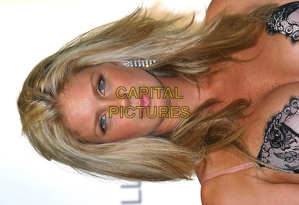 RACHEL HUNTER.at the launch of Ultimo Lingerie Autumn/Winter Collection, Selfridges, London, 5th September 2004..portrait headshot.Ref: BR.www.capitalpictures.com.sales@capitalpictures.com.©Capital Pictures.
