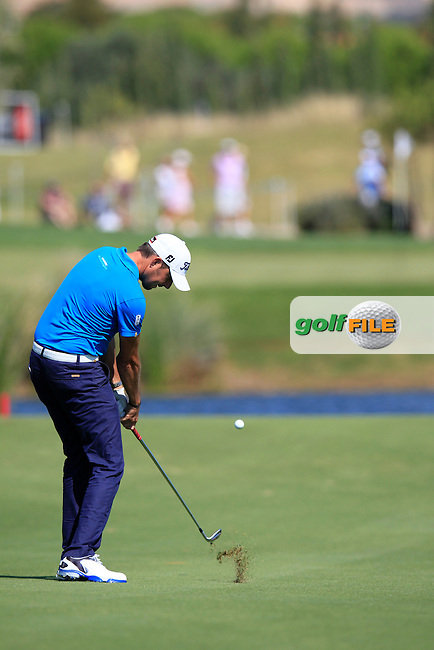 Simon Thornton (IRL) plays his 3rd shot on the 17th hole during Thursday's Round 1 of the 2013 Portugal Masters held at the Oceanico Victoria Golf Club. 10th October 2013.<br /> Picture: Eoin Clarke www.golffile.ie