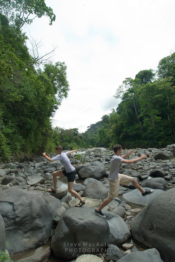 Young boy and girl playing on rocks, Chiriqui Viejo, Panama