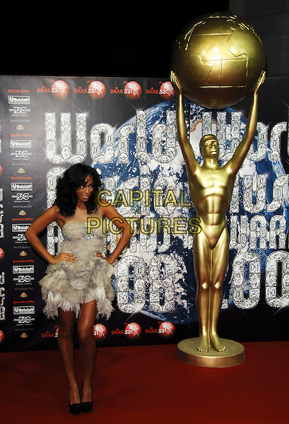 SOLANGE KNOWLES.At the World Music Awards in Monte Carlo, Monaco, 9th November 2008..arrivals red carpet full length grey gray white strapless ruffles dress gathered hands on hips  black shoes heels feathers .CAP/TTL .©TTL/Capital Pictures