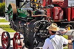 Person operating an old steam engine. Toronto Canada.