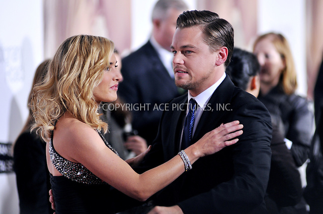 WWW.ACEPIXS.COM . . . . . ....December 15 2008, Hollywood....Actors Kate Winslet and Leonardo DiCaprio at the World Premiere of Dreamworks Pictures and Paramount Vantage film 'Revolutionary Road' on December 15, 2008 at Mann's Village Theatre in Westwood, California.....Please byline: JOE WEST- ACEPIXS.COM.. . . . . . ..Ace Pictures, Inc:  ..(646) 769 0430..e-mail: info@acepixs.com..web: http://www.acepixs.com
