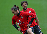 (L-R) Gareth Bale and Ashley Williams warm up during the Wales Training Session at the Vale Resort, Hensol, Wales, UK. Tuesday 29 August 2017