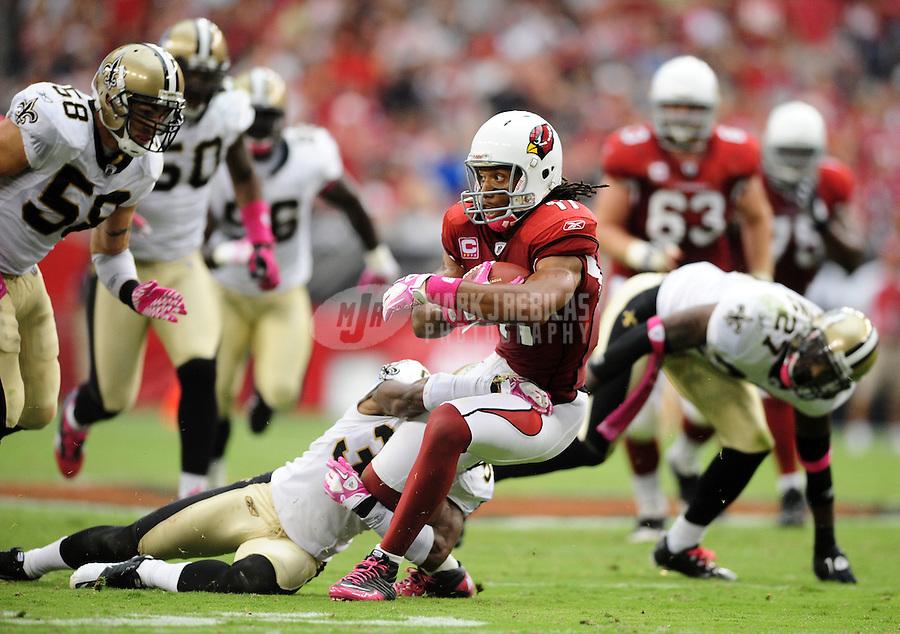 Oct. 10, 2010; Glendale, AZ, USA; Arizona Cardinals wide receiver (11) Larry Fitzgerald runs the ball in the second quarter against the New Orleans Saints at University of Phoenix Stadium. Mandatory Credit: Mark J. Rebilas-