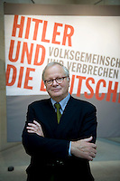DEU, Deutschland, Germany, Berlin, 15.10.2010.Curator, Prof. Dr. Hans-Ulrich Thamer in front of a poster at the exhibition Hitler and the Germans Nation and Crime, Hitler und die Deutschen Volksgemeinschaft und Verbrechen, at the Deutsche Historische Museum, German Historical Museum, in Berlin, Germany. The new exhibition opening in Berlin has Adolf Hitler as its focus for the first time. It seeks to answer the question of why so many Germans chose to follow Hitler and his fascist ideology and so devotedly despite the horrors of World War II and the Holocaust. Exhibition hitler and the Germans. Exhibition, culture, cultural, visitor, visitors,  work of art, art, europe, exhibitions, exposition, expositions, geman, show, German, Germany, Europe, 2010, Event, Politics, Adolf Hitler, Fascism, Nazism, Arts Culture and Entertainment, display..[(c) Stefan Boness/Ipon - Veroeffentlichung nur gegen Honorar (zuzuegl. MwSt.), Namensnennung und Beleg; Kto.: 940165350, Bln. Spk., BLZ 100 500 00; Claudiusstr. 6, 10557 Bln, Phone: ++49-(0)30-3934318, www.iponphoto.com, e-mail: boness@iponphoto.com; No Model Release. Vereinbarungen ueber Model Release / Abtretung von Persoenlichkeitsrechten der abgebildeten Person/Personen liegen nicht vor.]