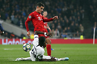Tanguy NDombele of Tottenham Hotspur earns a yellow card for this tackle on Philippe Coutinho of Bayern Munich during Tottenham Hotspur vs FC Bayern Munich, UEFA Champions League Football at Tottenham Hotspur Stadium on 1st October 2019