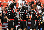 24 April 2004: DC United's Mike Petke (12), Brian Carroll (16) and Earnie Stewart (8) during the playing of the national anthem before the game. The Chicago Fire defeated DC United 1-0 at RFK Stadium in Washington, DC on opening day of the regular season in a Major League Soccer game..
