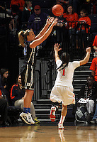 Duke guard Tricia Liston (32) shoots over Virginia guard China Crosby (1) during an NCAA college basketball game in Charlottesville, Va. Duke defeated Virginia 62-41...