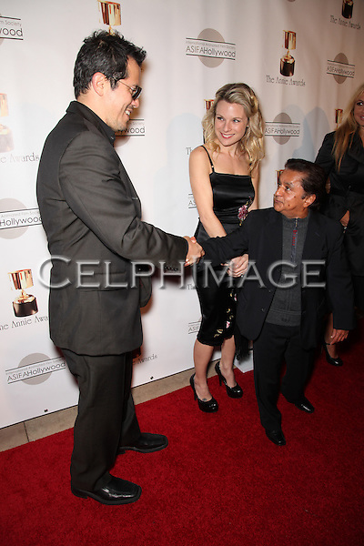 JOHN LEGUIZAMO, DEEP ROY. Red Carpet arrivals to the 37th Annual Annie Awards Gala at Royce Hall on the UCLA campus. Los Angeles, CA, USA. February 6, 2010.