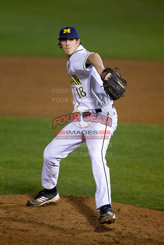 Michigan Wolverines pitcher Kyle Clark #18 delivers a pitch during a game against the Pittsburgh Panthers at the Big Ten/Big East Challenge at Florida Auto Exchange Stadium on February 18, 2012 in Dunedin, Florida.  (Mike Janes/Four Seam Images)