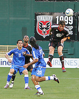 Marc Burch #4 of D.C. United  heads past Rudolfo Zelaya #11 and Josue Flores #20 of El Salvador during an international charity match at RFK Stadium, on June 19 2010 in Washington DC. D.C. United won 1-0.