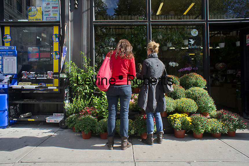 Women shop for fall flowers at a florist in the Upper West Side neighborhood of New York on Friday, October 12, 2012. (© Richard B. Levine)