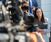 White House Press Secretary Stephanie Grisham listens as United States President Donald J. Trump speaks to the media at the White House, August 7, 2019 before departing to visit El Paso, TX and Dayton Ohio after recent shootings in those cities. <br /> CAP/MPI/RS<br /> ©RS/MPI/Capital Pictures