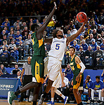 BROOKINGS, SD - FEBRUARY 1: David Jenkins Jr. #5 from South Dakota State University drives to the basket against Deng Geu #23 from North Dakota State University during their game Thursday at Frost Arena in Brookings. (Photo by Dave Eggen/Inertia)