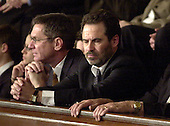 Comedian Dennis Miller listens intently to United States President George W. Bush during the State of the Union Address at the United States Capitol in Washington, DC on January 20, 2004.<br /> Credit: Ron Sachs / CNP