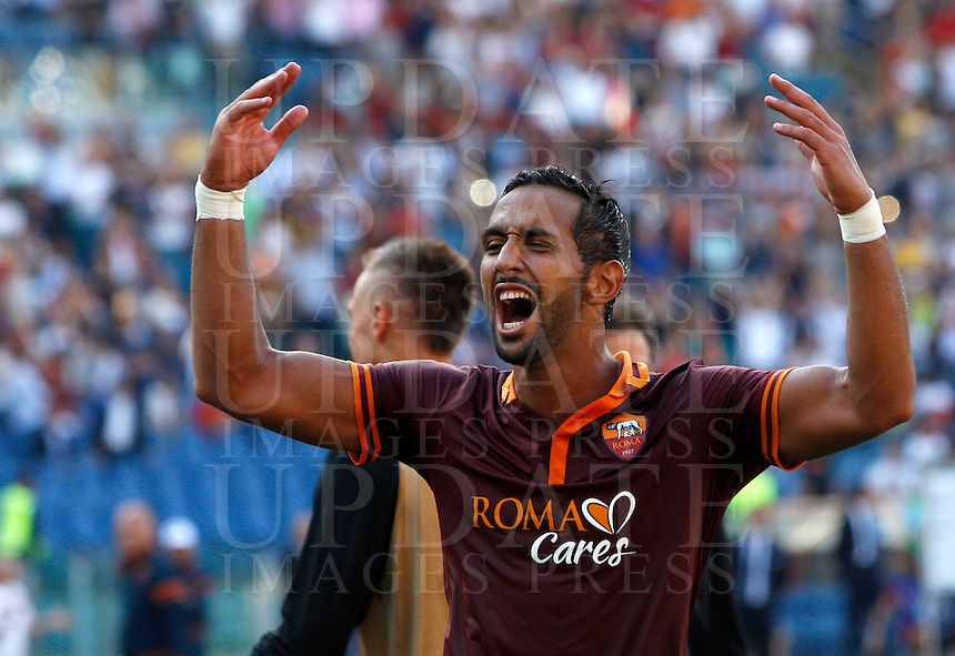 Calcio, Serie A: Roma vs Lazio. Roma, stadio Olimpico, 22 settembre 2013.<br /> AS Roma defender Mehdi Benatia, of France, celebrates at the end of the Italian Serie A football match between AS Roma and Lazio, at Rome's Olympic stadium, 22 September 2013. AS Roma won 2-0.<br /> UPDATE IMAGES PRESS/Riccardo De Luca