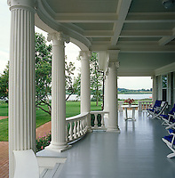 The classical veranda is furnished with contemporary garden chairs