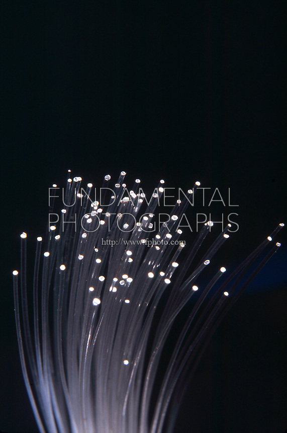 FIBER OPTICS<br /> A bundle of glass threads each of which can transmit data modulated onto light waves. They are lighter and thinner than metal wires and can transmit more information.