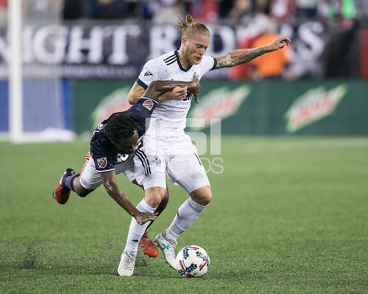 Foxborough, Massachusetts - August 12, 2017:  The New England Revolution (blue/white) beat Vancouver Whitecaps FC  (white) 1-0 in a Major League Soccer (MLS) match at Gillette Stadium.